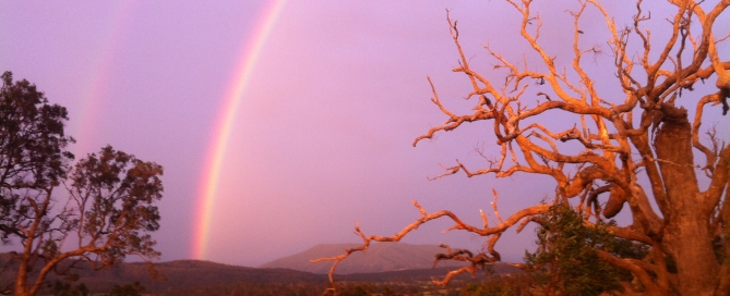 Rainbows over saced mountain
